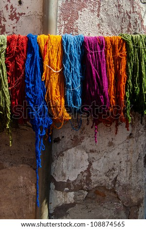 Different colors of yarn at the tanneries - stock photo