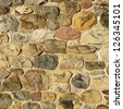 Different colors stones wall - stock photo