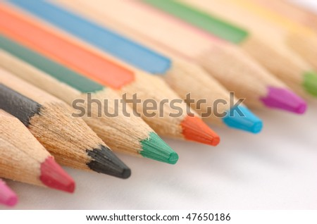 Different coloured pencils on a white background - stock photo