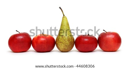 different concepts - pear between green apples