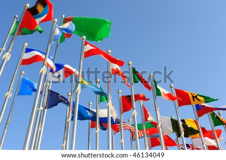 different countries flags united together against blue sky - stock photo
