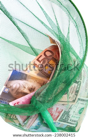 Different currencies caught in a fishing net - stock photo
