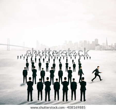 Different deirection concept with arrow shaped crowd of businesspeople going in one direction and just one person walking away - stock photo