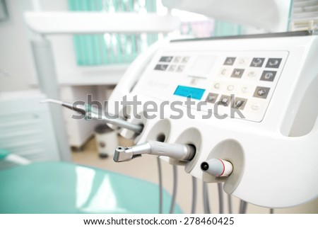 Different dental instruments and tools in a dentists office. - stock photo