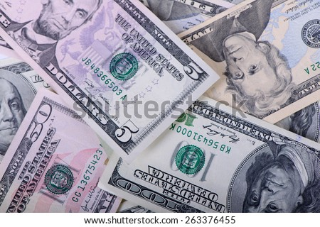 Different dollar banknotes as a background close-up - stock photo