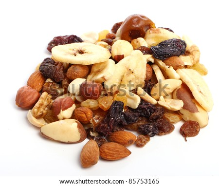 Different dried fruits against white background - stock photo