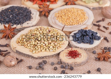 Different dry  spices on a   burlap background