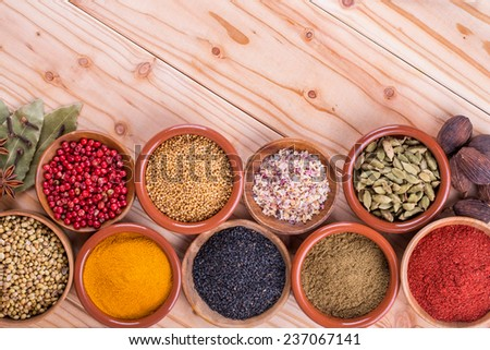 Different dry  spices on a  wooden background - stock photo