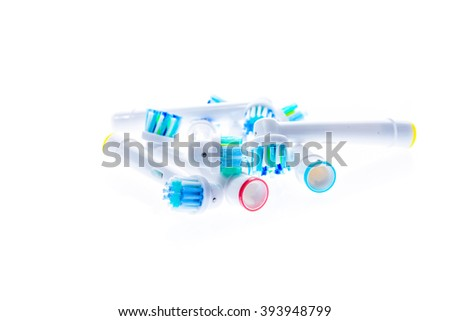 Different Electric Toothbrush replacement heads with color rings, isolated on white background. - stock photo