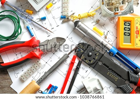 Different electrical tools on circuit diagram stock photo royalty different electrical tools on circuit diagram ccuart Image collections