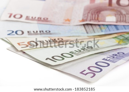 Different euro banknotes closeup on white background - stock photo