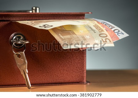 Different euro banknotes sticking out of an open moneybox - stock photo