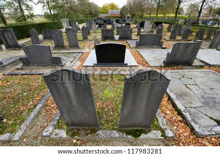 Different family graves on a cemetery - stock photo