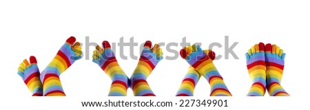 different feet with funny socks - stock photo