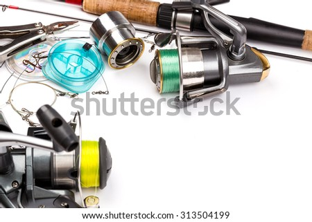 different fishing tackles - rod, reel, line and lures on white background - stock photo