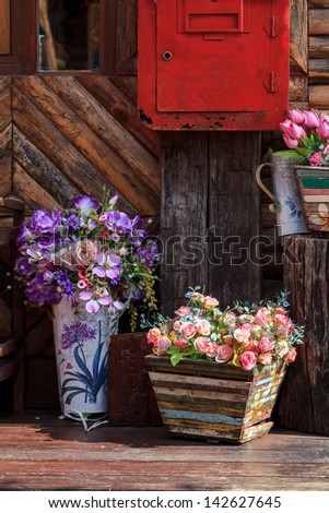 different flowerpots as decoration of countryside house - stock photo