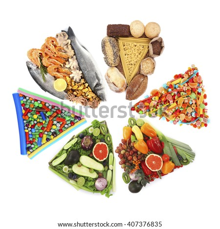 Different food in shape of triangles isolated on white - stock photo