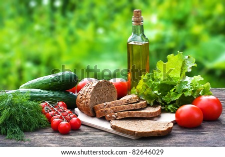 Different food ingredients on the old wooden table - stock photo