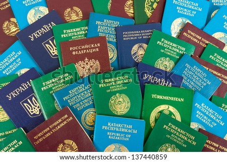 Different foreign passports as background - stock photo
