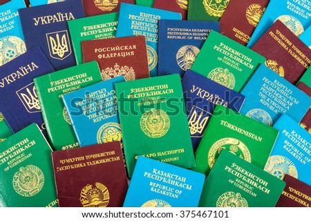 Different foreign passports as colorful background - stock photo