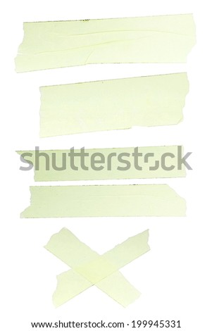 Different fragments of yellow scotch tape on white background isolated - stock photo