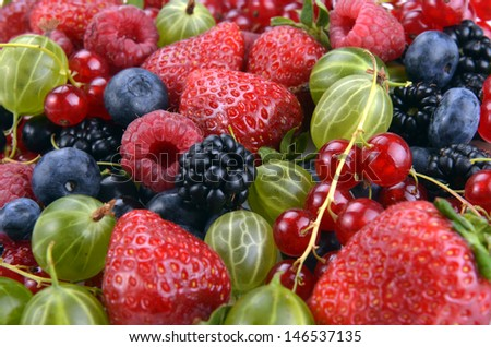 different fresh berries as background