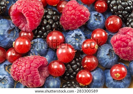 different fresh berries as background - stock photo