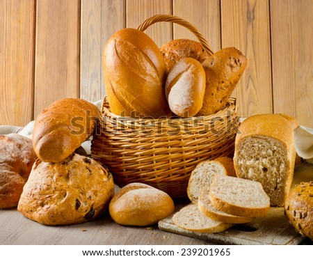 Different fresh bread in a basket  . Selective focus - stock photo