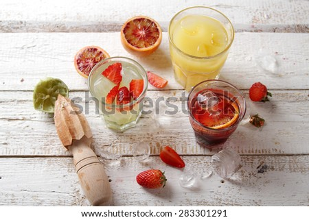 Different fresh cocktail on wooden background, selective focus - stock photo