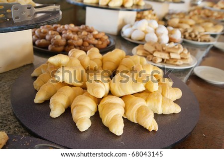 different fresh pastry in buffet at resort hotel - stock photo