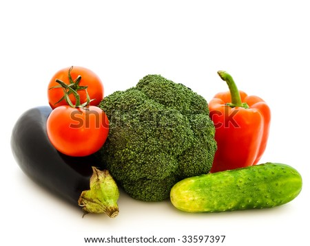different fresh ripe vegetables against white background - stock photo