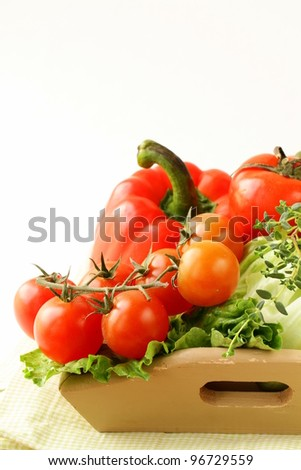 Different fresh vegetables in a wooden bowl - stock photo