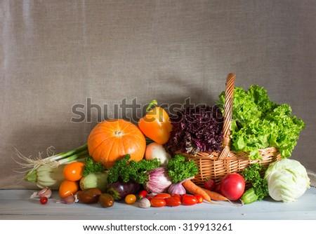 Different fresh vegetables in basket. Still life of fresh vegetables. - stock photo