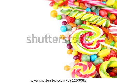 Different fruit candies on white background - stock photo