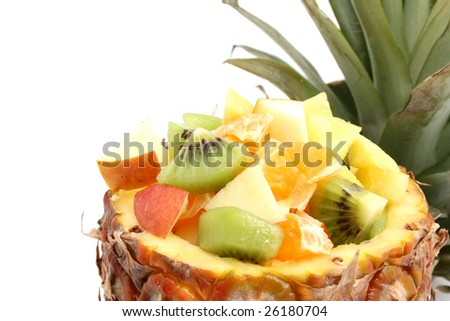 different fruit in pineapple with leafs