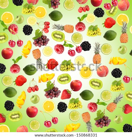 Different fruits and berries on blue background - stock photo