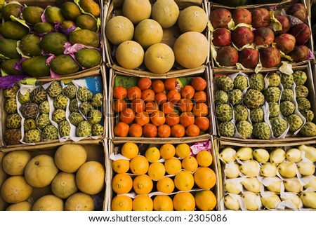 Different fruits in boxes on a counter of street shop in Egypt - stock photo