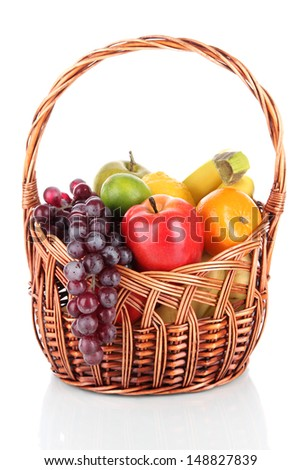 Different fruits in wicker basket isolated on white - stock photo