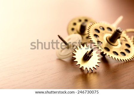 Different gears on the table - stock photo