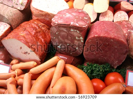 Different german gastronomic meat and sausage specialties in a german butcher's shop - stock photo