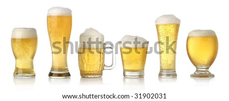 Different glasses of cold lager beer isolated on white - stock photo
