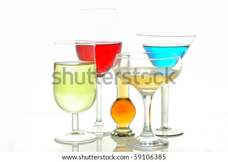 Different glasses with alcoholic drinks - stock photo