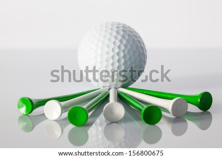 Different golf equipments on the glass table