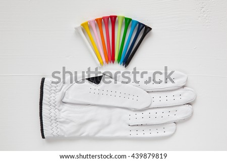 Different  golf equipments on the white desk - stock photo