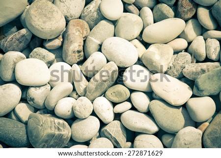 Different gray stones pebble beach. Toned. Selective focus. - stock photo