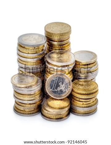 Different height stacks of Euro coins isolated on white background. - stock photo