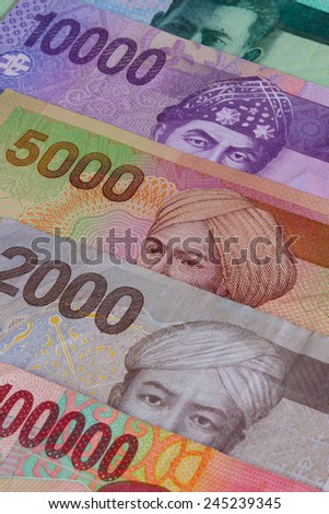 Different Indonesian rupiah banknotes on the table - stock photo