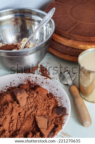 different ingredients to make a delicious chocolate layer cake - stock photo