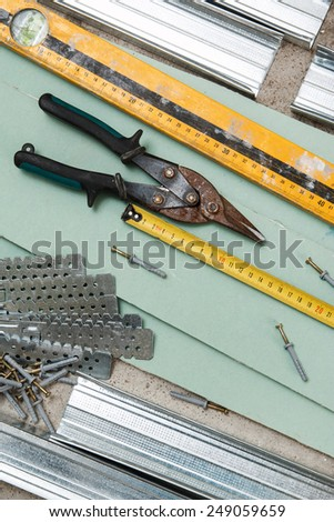 Different instruments and materials for build a plasterboard walls - stock photo
