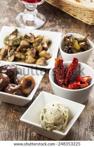 different italian antipasti and red wine  - stock photo